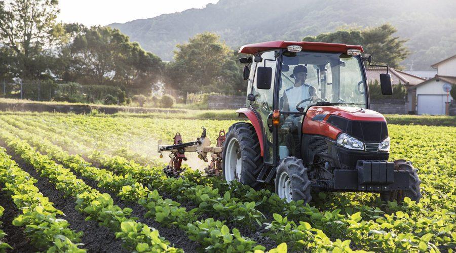 Farmer applying products